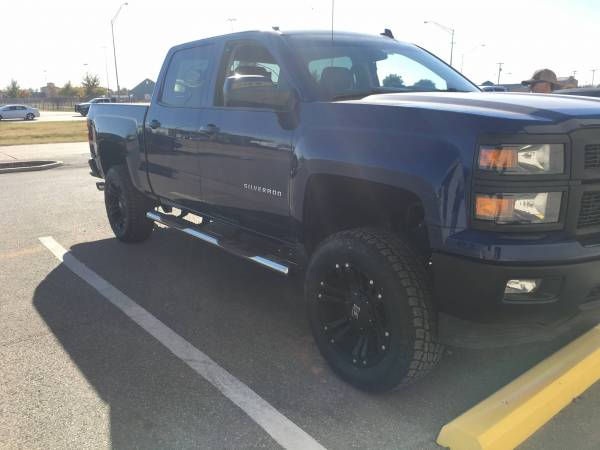 Lift Kit, Wheels and Tires, and Line-X Black Out Kit